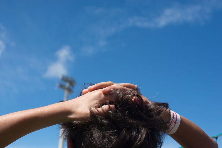 Emotions Blue Cloud - Sky Emotion Hands Human Hair Low Angle View Person Sky Young Adult