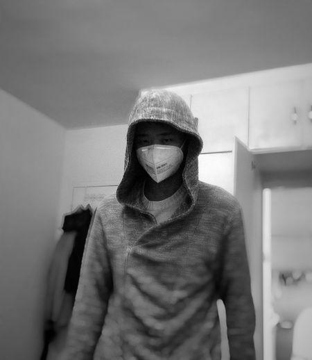 Man wearing gas mask at home