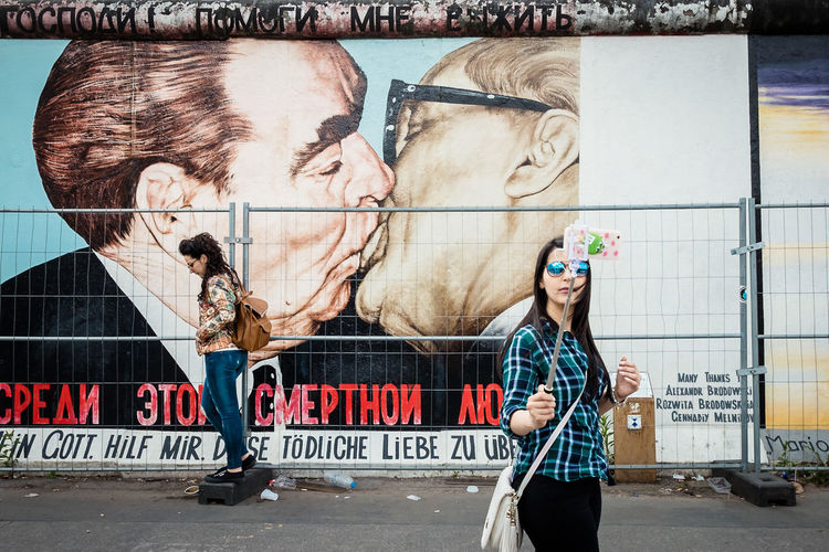 Adult Adults Only Berlin Casual Clothing Communication Day Division East Side Gallery Friendship Graffiti Graffiti Art Graffiti Wall Kiss One Person Outdoors People Real People Reunited  Selfie Standing Text The Street Photographer - 2017 EyeEm Awards Young Adult Discover Berlin Discover Berlin Connected By Travel An Eye For Travel Visual Creativity