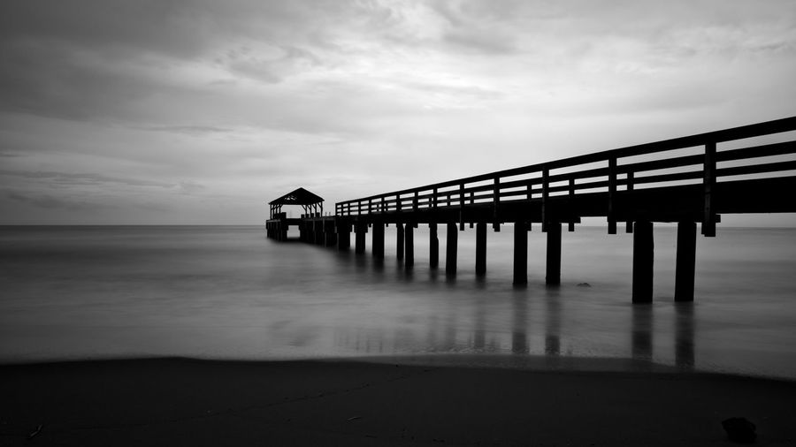 Sky Water Built Structure Sea Cloud - Sky Architecture Pier Beach Nature Scenics - Nature Tranquil Scene Beauty In Nature Architectural Column Tranquility No People Transportation Connection Land Outdoors Long Peer Blackandwhite Black And White EyeEmNewHere A New Perspective On Life