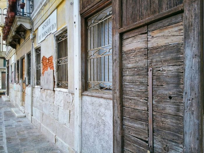 Venice Veneto Italy Travel Travel Photography Traveling Dream Destinations Mobile Photography Architecture Historical Buildings Building Facades Attractive Textures Wooden Door Textures Stone Textures Line Intersections