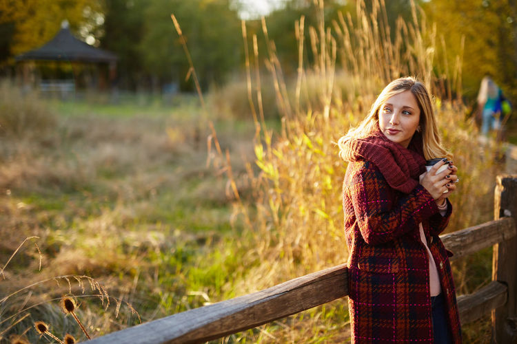 Autumn Beautiful People Beautiful Woman Beauty Day Focus On Foreground Grass Happiness Leisure Activity Lifestyles Looking At Camera Nature One Person Only Women Outdoors Portrait Real People Rural Scene Smiling Standing Tree Winter Women Young Adult Young Women