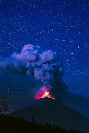 The most amazing photo to date. Shooting stars, MILKY WAY, Gunung Agung Volcano by Night. STUNNING! Thanks Kyle Kesterson. Night Star - Space Volcano Lava Milky Way Nature Accidents And Disasters Mountain No People Astronomy Landscape Sky Science Erupting Gas Arts Culture And Entertainment Outdoors Blue Power In Nature Beauty In Nature Be. Ready. EyeEmNewHere