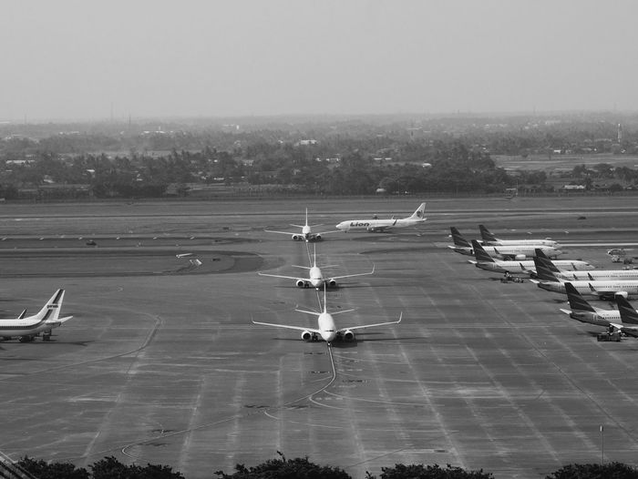 air trafic flow Air Traffic Control Tower Sea Airport Runway Military Beach City Airplane High Angle View Horizon Over Water Sky Runway Cockpit Pilot Aircraft Aeroplane