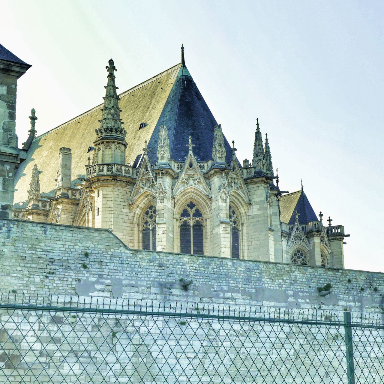 architecture, building exterior, built structure, sky, building, place of worship, fence, spirituality, religion, low angle view, boundary, barrier, nature, belief, the past, travel destinations, history, no people, outdoors, gothic style, spire