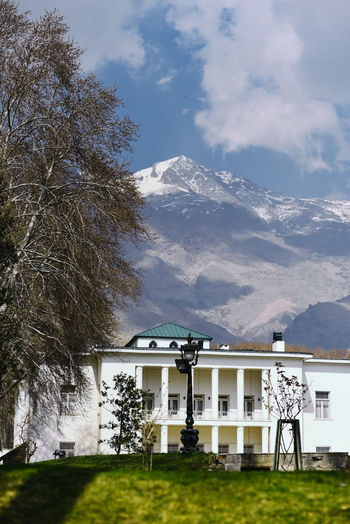 Saad Abad Complex in Tehran in Iran Residential  Saad Abad Complex Tourist Attraction  Architecture Built Structure Famous Place Iran Mountain Mountain Range No People Residential Building Shah Snowcapped Mountain Tehran Tehran, Iran Travel Destinations