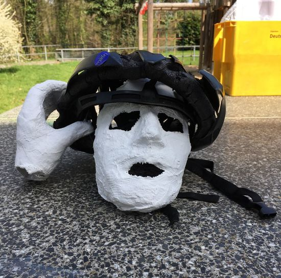 Helmet. Bicycles. Damaged by car. 78655