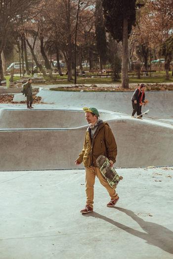 People walking by tree in city