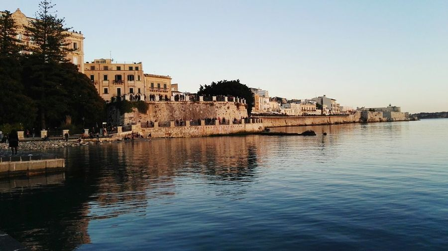 Lungomare Alfeo, Ortigia, Siracusa, Italy  Sea And Sky Siracusa Sicily Sicily, Italy Italy Sicilia Italia Siracusa, Italy,Sicilia Ortigia Aretusa Alfeo Water Tree Clear Sky Sea Beach City Old Ruin Sky Architecture Building Exterior Fort Old Town Fortress Castle Historic History