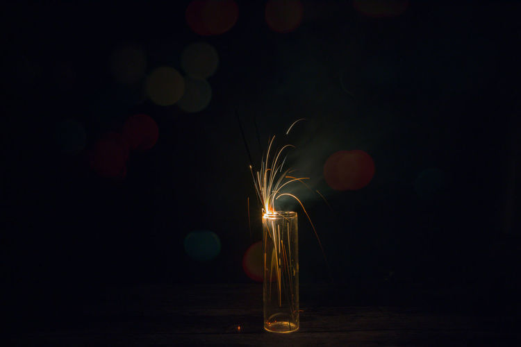 Abstract Blurred Sparklers background. Festival Season. Event Festival Season Fireworks Light Background Bokeh Close-up darkness and light Festival Fire Firecracker Glowing Illuminated Indoors  Lens Flare Motion Nature Night No People Sparklers Sparks Table