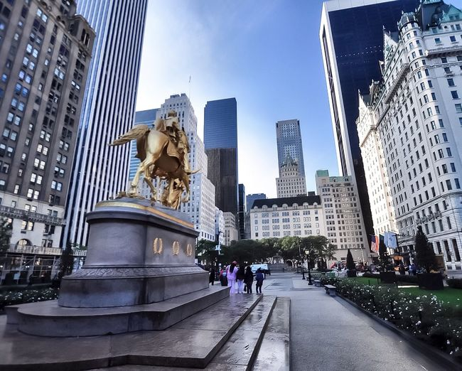 Statue Architecture Human Representation Sculpture Building Exterior Built Structure Art And Craft Male Likeness City Central Park Urban Skyline Urban Landscape Travel Destinations Outdoors Sky Day Skyscraper Modern No People Summer