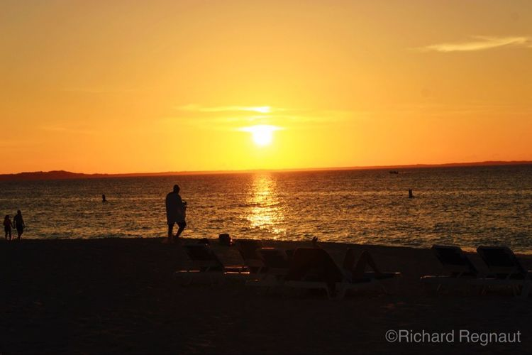 Sunset Sea Horizon Over Water Water Silhouette Tranquil Scene Scenics Tranquility Sun Orange Color Beach Idyllic Vacations Beauty In Nature Tourism Sky Nature Tourist Majestic Atmosphere Grace Bay Sunset Providenciales Turks And Caicos Island First Eyeem Photo