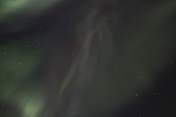 Low angle view of northern lights at night