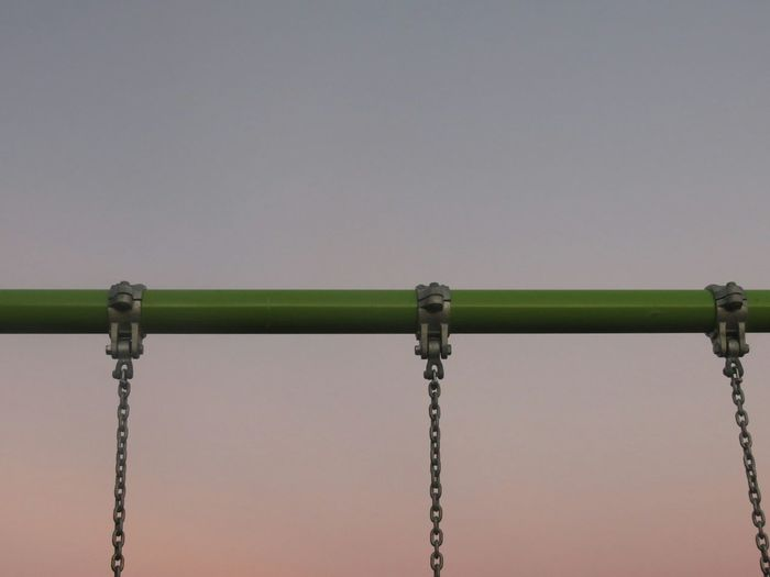 Sky Low Angle View Green Color Clear Sky No People Connection Nature Outdoors Day Swing Chains Dusk Blue Sky Peach Sky Painted Metal Metal Structure Green Looking Up Minimalist Abstract Playground Childs Play Park Playground Equipment Swingset