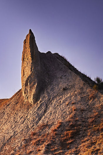 Dente della Poiana Bologna Emilia Romagna Italia Beauty In Nature Calanchi Dente Della Poiana Golden Hour Italy Landscape Mountain Nature Rock Formation Sky Sundown Sunset Valsamoggia
