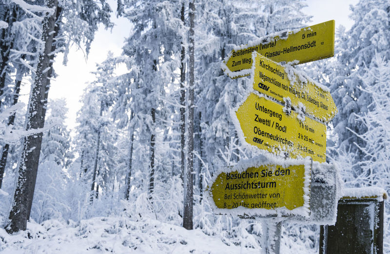 Information sign on snow covered land