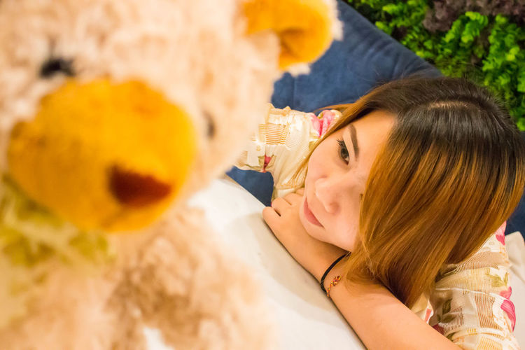 On the Road Adult Childhood Hair Hairstyle Happiness Headshot Holding Indoors  One Person Portrait Representation Smiling Stuffed Toy Teddy Bear Toy Women Young Adult Young Women