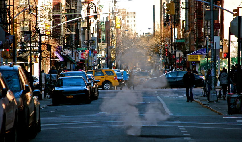 Smoke coming out from sewage amidst street