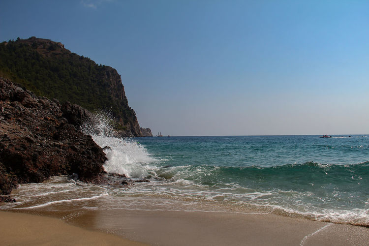 Sea Water Beach Land Beauty In Nature Sky Wave Motion Scenics - Nature Horizon Over Water Nature Horizon Clear Sky Sport Aquatic Sport No People Copy Space Tranquility Power In Nature Outdoors Flowing Water Breaking Travel Alanya Turkey