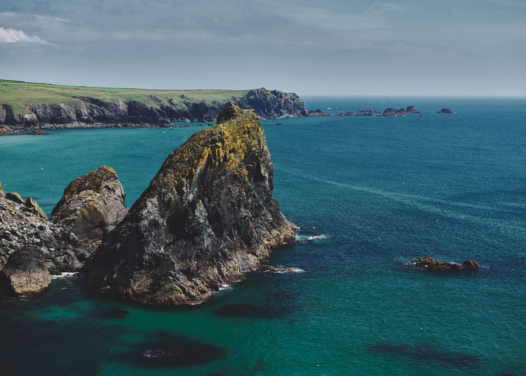 Scenic view of sea against sky at kynance cove in cornwall, england