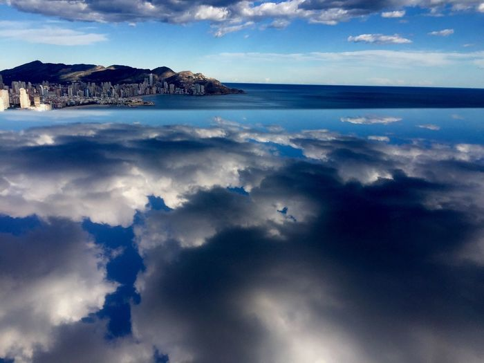 Weekendchallenge Clouds And Sky Reflection Spain ♥ Landscape IPhoneography I used a reflective railing to create this Forced Perspective Forcedperspective shot with my phone. Lines aren't perfect but I think it's interesting enough to share.