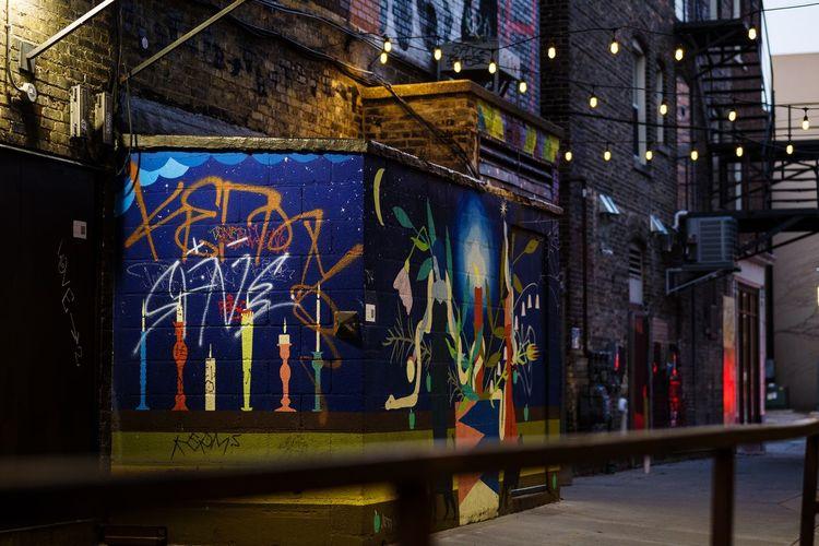 Graffiti on building wall at night