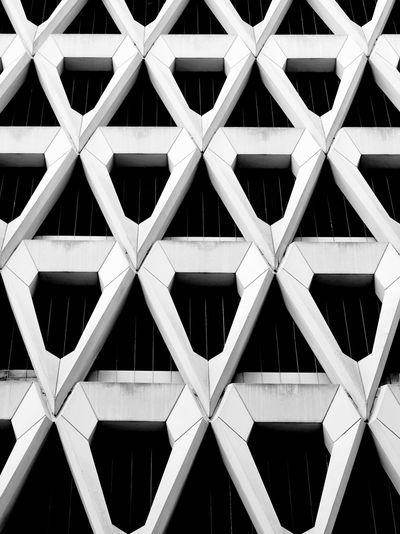 Full frame shot of a building façade formed of diamond-shaped pre-cast concrete units