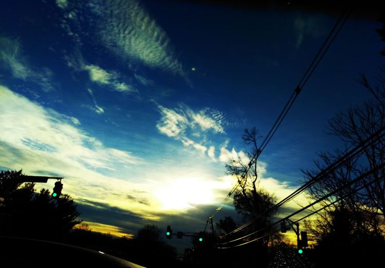 """""""Spining off-center..."""" Sky Low Angle View Outdoors Building Exterior Tree City Silhouette No People Sunbeam Nature Vapor Trail Architecture Star - Space As Shot Purist No Edit No Filter Outofthewayangles Mobile Photography Claritycounts Njphotography Transportation Getting Back On Track Windshield Dramatic Sky Cloud_collection"""