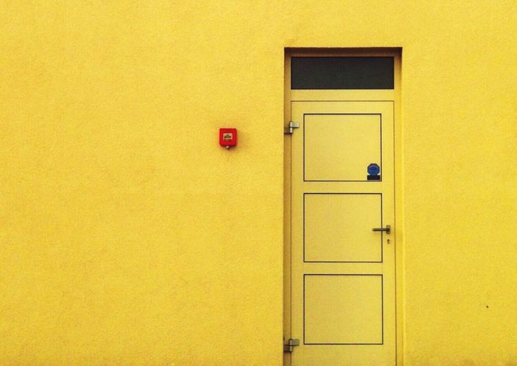 Minimalist Architecture Yellow Door Building Exterior Closed Built Structure Architecture Entrance Protection Front Door Closed Door No People Close-up Outdoors Day Paint The Town Yellow