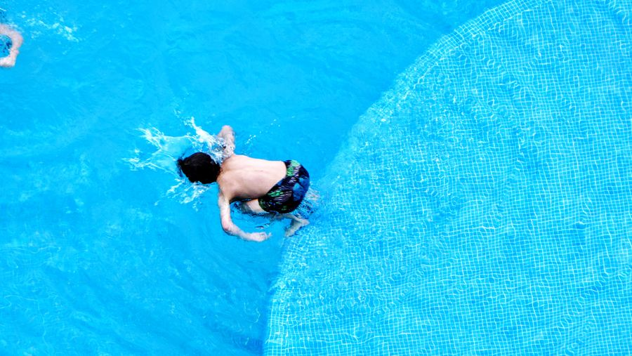 High angle view of man swimming in pool