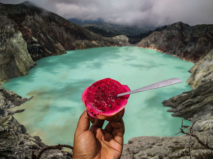 Enjoying dragon fruit in the top mount Ijen. Beautiful Food And Drink INDONESIA Volcano Crater Acid Lake Banyuwangi Beauty In Nature Buah Naga Crater Delicious Dragon Fruit Food Fruit Go Higher Hand Human Hand Ijen Ijen Crater Indonesia_photography Kawah Ijen Mountain Nature Outdoors Rock Volcano