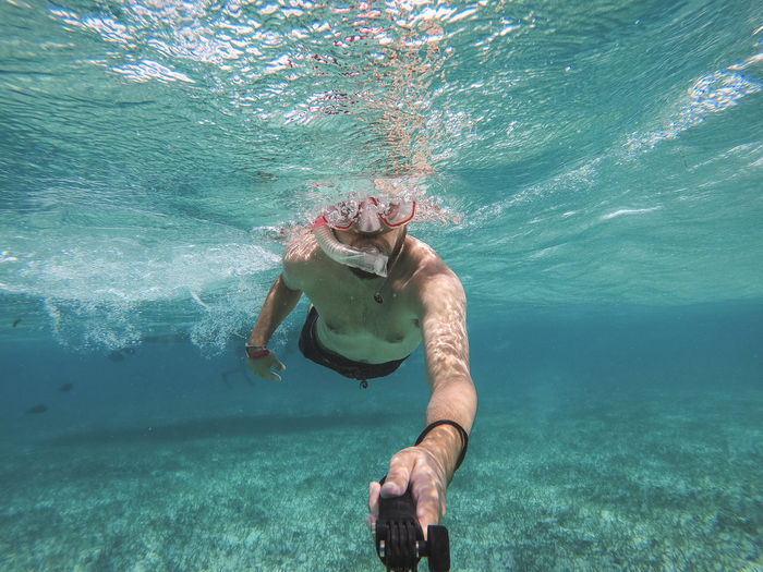 Belize  Snorkeling Adventure Caye Caulker Happiness Leisure Activity Lifestyles One Person Outdoors Scuba Diving Sea Snorkel Summer Swimming UnderSea Underwater Vacations Water Young Adult Go Higher