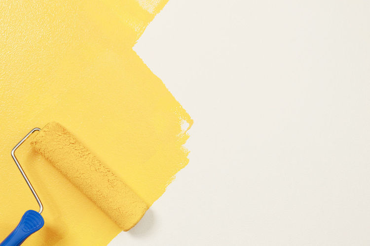 Close-up of yellow wall against white background