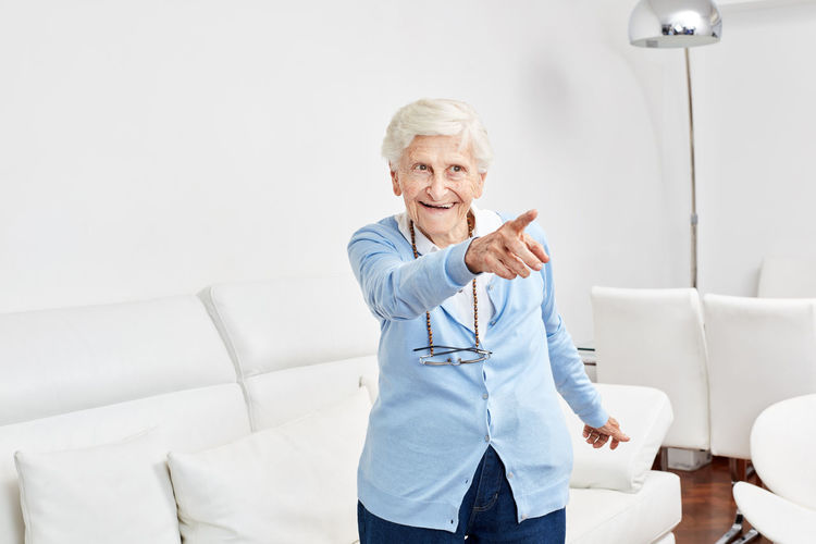Smiling senior woman looking away at rehab
