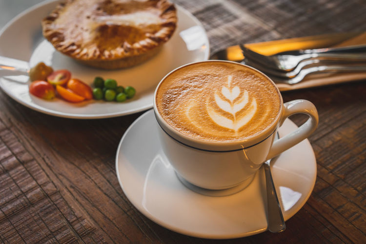 Breakfast Coffee Coffee - Drink Coffee Cup Crockery Cup Drink Eating Utensil Food Food And Drink Freshness Frothy Drink High Angle View Hot Drink Indoors  Kitchen Utensil Latte Meal Mug No People Refreshment Saucer Spoon Still Life Table
