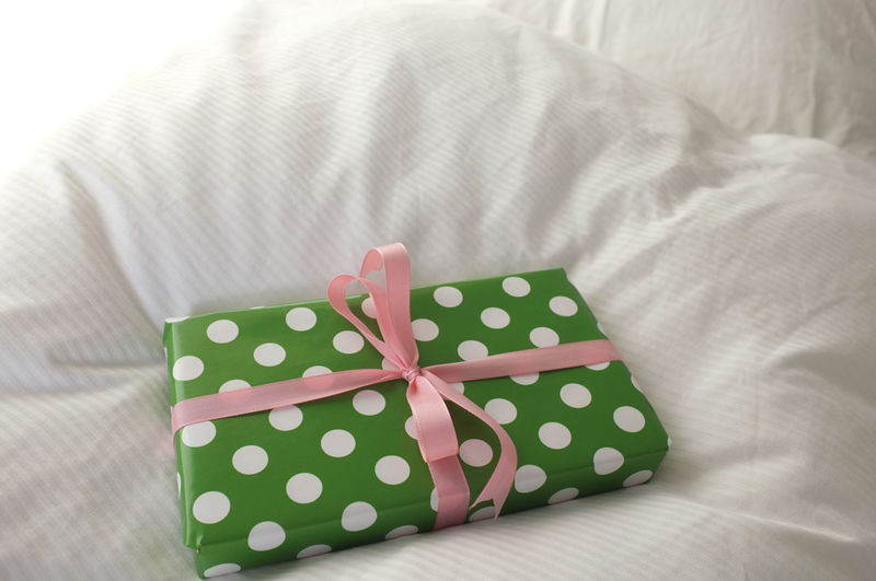 Gift Furniture Bow Ribbon - Sewing Item Ribbon Tied Bow Indoors  Wrapping Paper Bed Still Life Wrapped Surprise Paper Box No People Box - Container Celebration High Angle View Close-up Gift Box Polka Dot Present Birthday