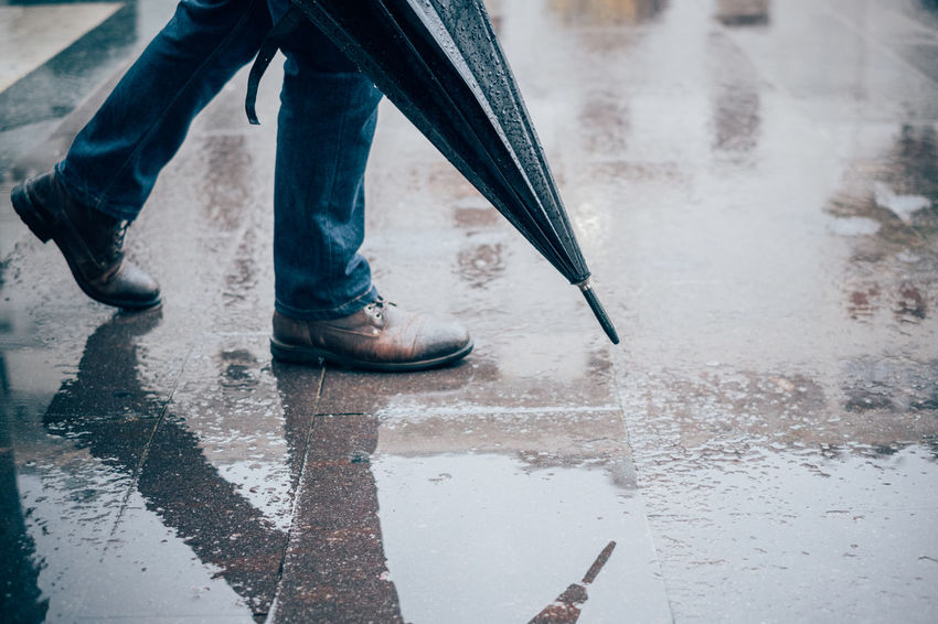 Rainy Days Day Human Leg Low Section Men One Person Outdoors People Puddle Real People Umbrella Walking Water Watereflexion Wet
