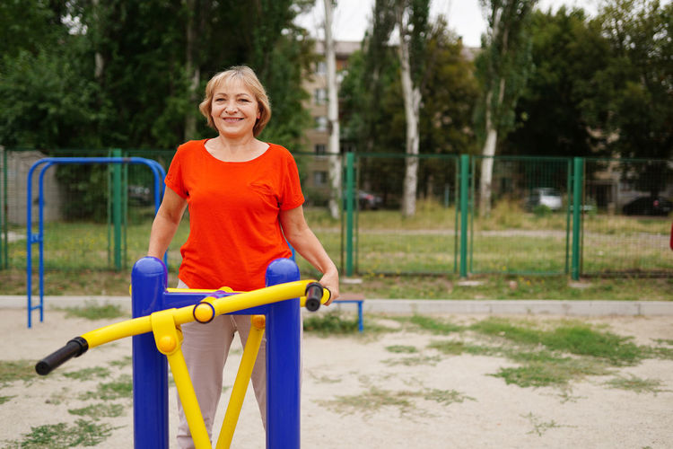 Portrait of a smiling young woman in playground