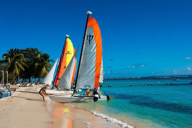 Beach v Vacations Sea Horizon Over Water Travel Destinations Sailboat Outdoors Beauty In Nature Guadeloupe-F.W.I People Of The Oceans Water Beauty In Nature Idyllic Tourism People Tranquil Scene Guadeloupeislands Beautiful Nature