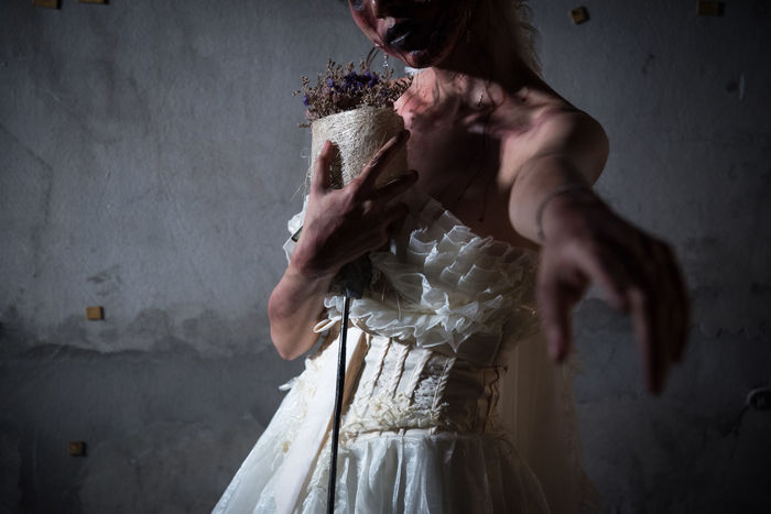 Ghost Halloween Wedding Zombie Adult Blood Bride Corpse Corpse Bride  Corpse Flower Day Flower Hand Haunted Holding House Human Hand Indoors  One Person People Real People Standing Wedding Dress Witch Zombies