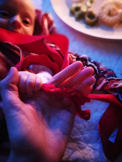 Closing. Women Baby Candle Light Close-up Red Ribbon Rebozo Nofilter No Filter, No Edit, Just Photography Evening