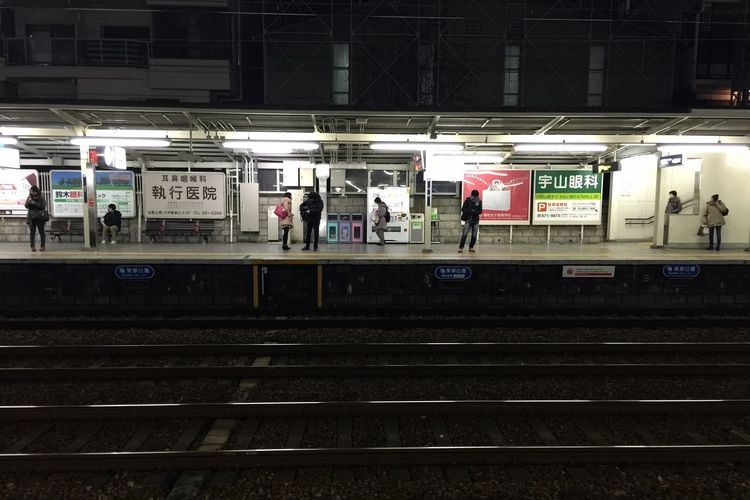 Commuters waiting for train on a platform at Rokko station in Kobe Kx2014 Traveling Streetphotography