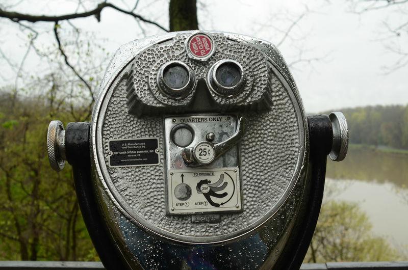 Outdoor coin operated binoculars overlooking lake
