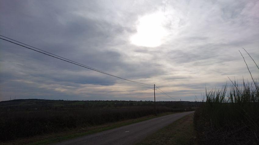 Lignes de fuite & vague à l'âme Electricity  Cloud - Sky Nature No People Rural Scene Extreme Weather Outdoors Day Sky Sunlight Landscape Tranquility Sun Cloudscape Dramatic Sky Tranquil Scene