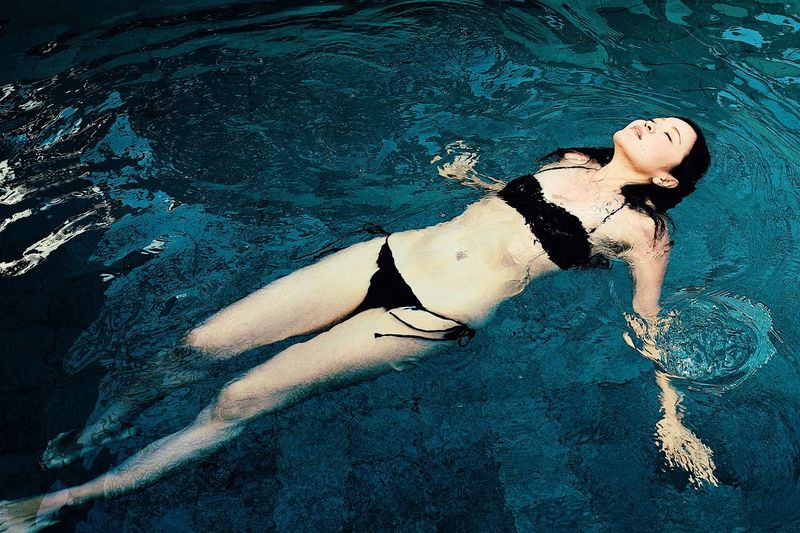 High angle view of young woman in swimming pool