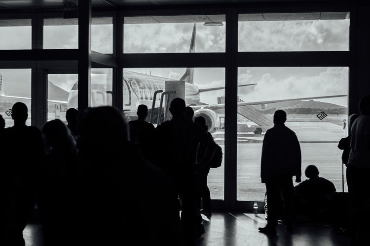 Silhouette people waiting at airport