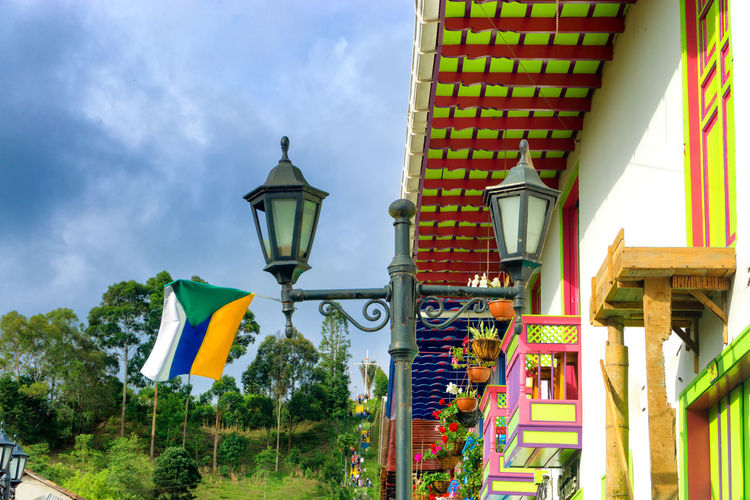 Flag waving in the wind with colorful colonial architecture in Salento, Colombia America Architecture Balcony Building Colombia Colonial Colorful Countryside Culture Destination Façade Flag Historic Houses Outdoors Quindío Salento South Tourist Touristic Town Travel View Village Window