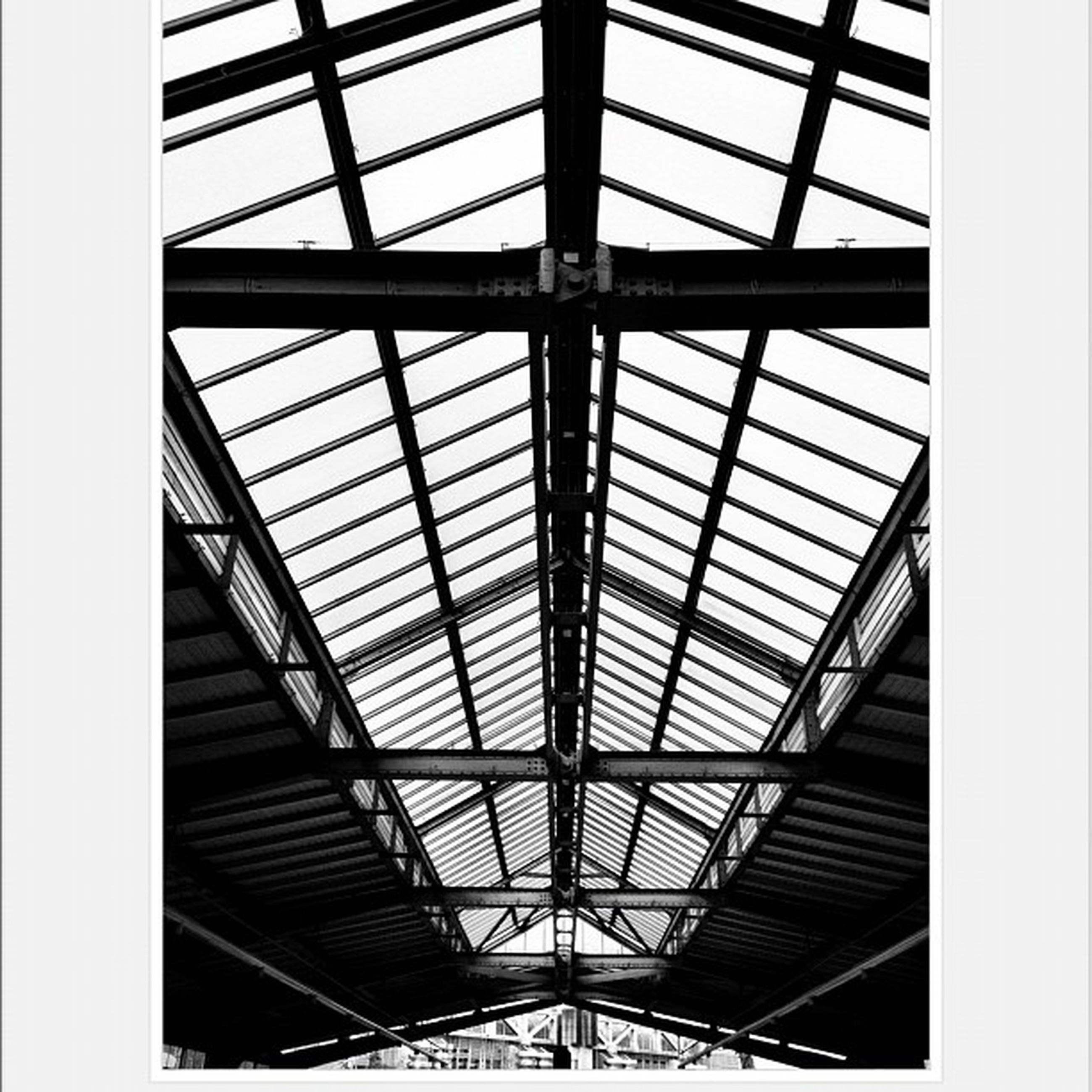 indoors, ceiling, architecture, built structure, skylight, low angle view, glass - material, pattern, transfer print, window, transparent, architectural feature, modern, full frame, design, day, auto post production filter, directly below, no people, building