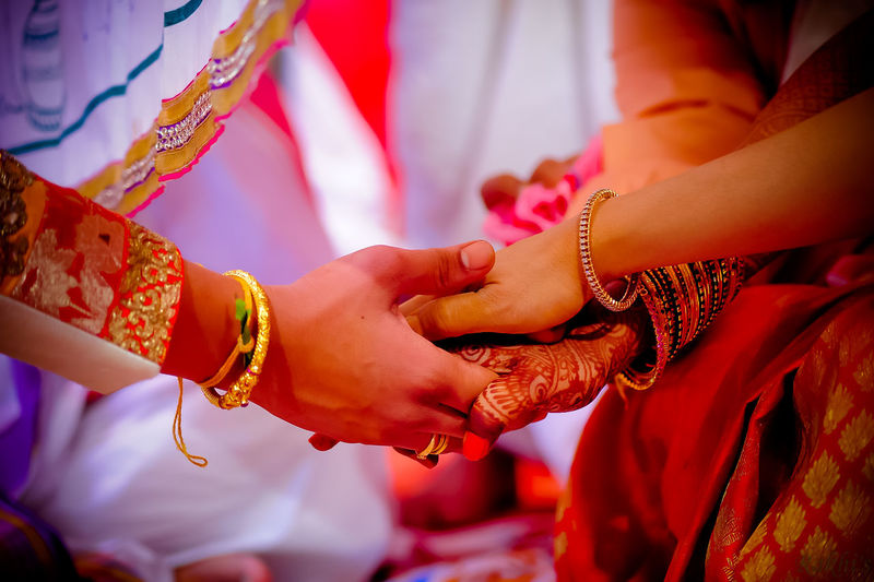 Close-Up Of Friends With Stacked Hands During Ceremony