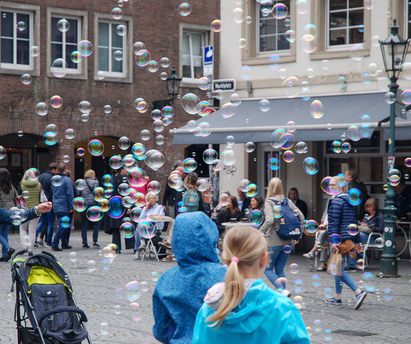 Bubble Childhood City Group Of People Large Group Of People Outdoors Real People Street Women